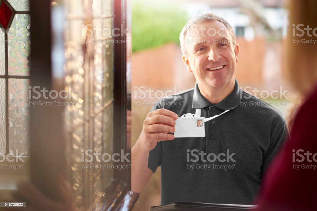 workman at the door stock photo