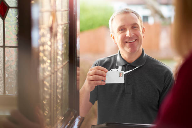 workman at the door - identity card stock photos and pictures