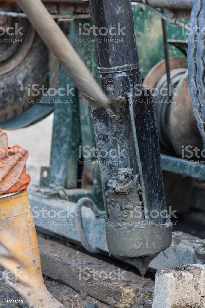 Workman drilling a borehole stock photo