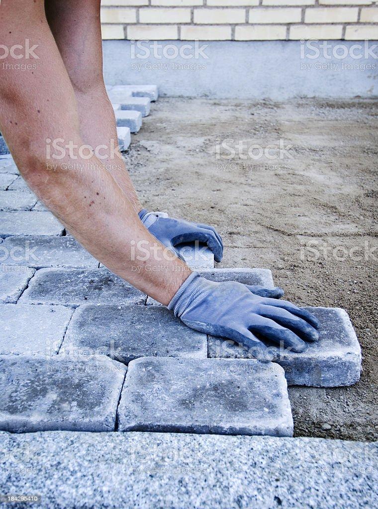 Workman Laying Block Paving. royalty-free stock photo