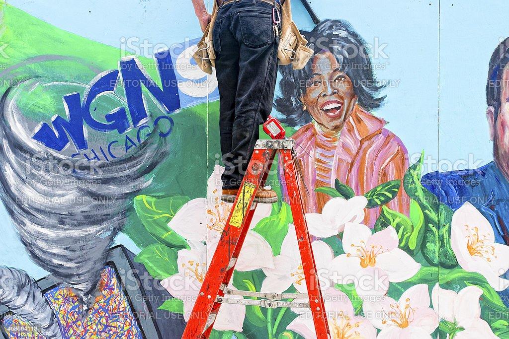 Workman On Ladder, Wall Mural of Oprah Winfrey royalty-free stock photo