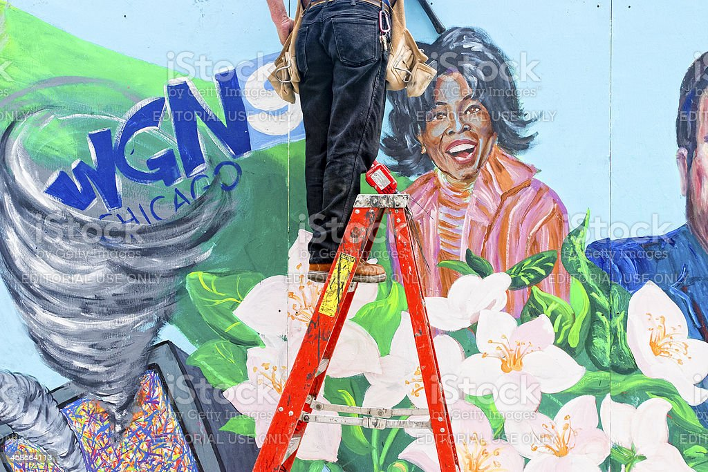 Workman On Ladder, Wall Mural of Oprah Winfrey stock photo