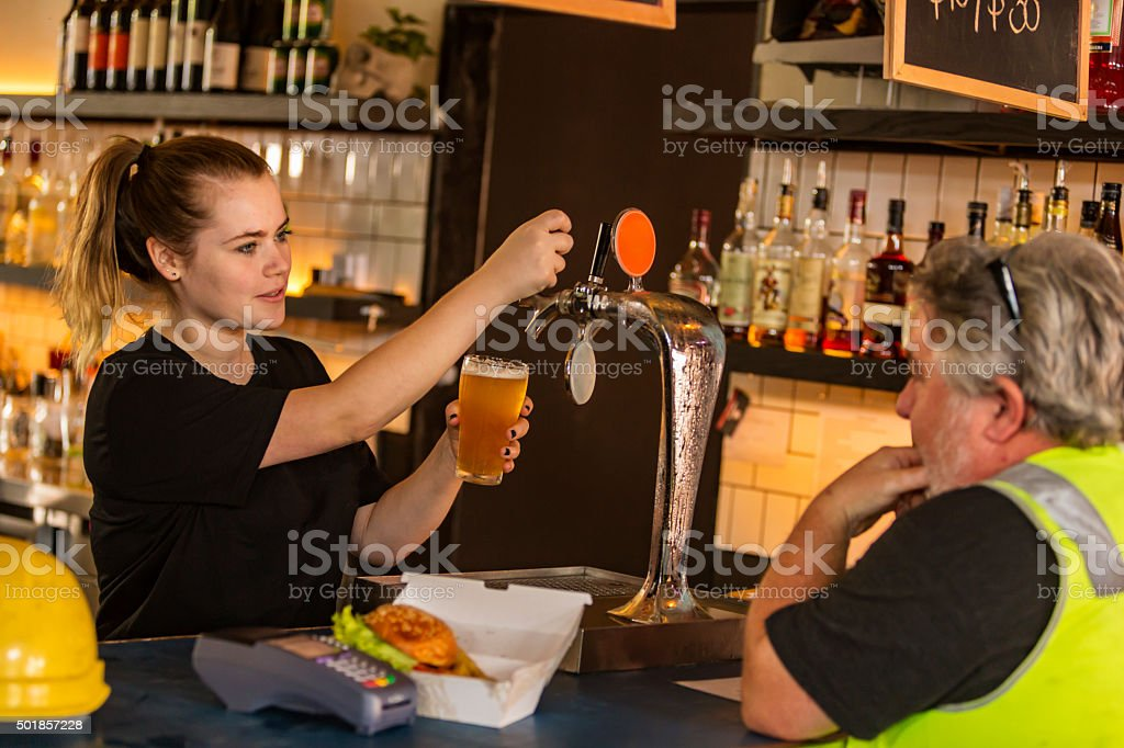 Workman Relaxing With Beer After Work in High Visibility Clothes stock photo