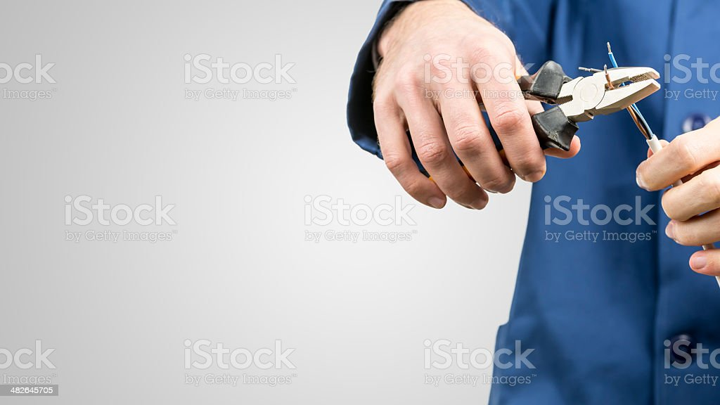 Workman repairing an electrical cable stock photo