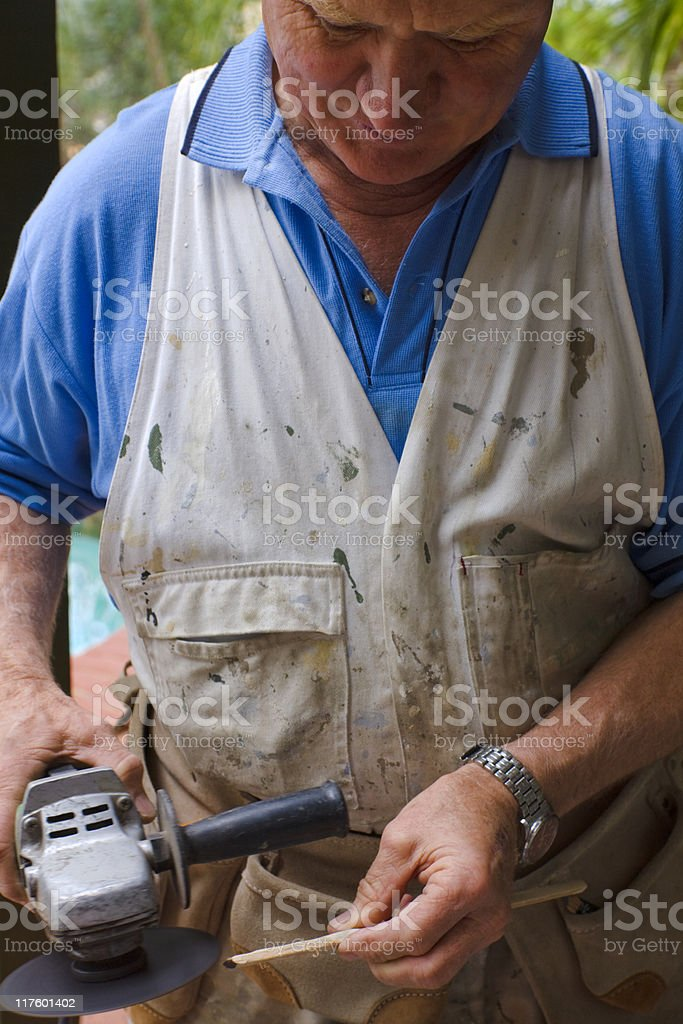 Workman shaping wood royalty-free stock photo