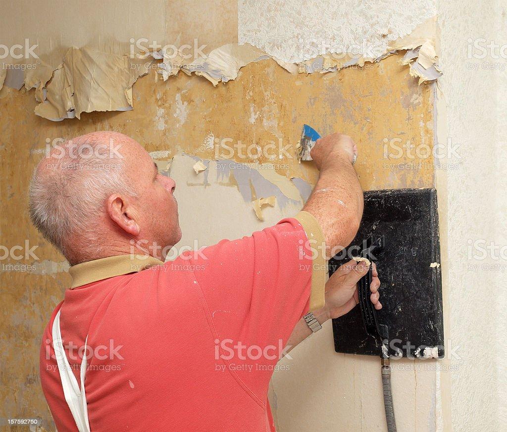 Workman Stripping Wallpaper royalty-free stock photo