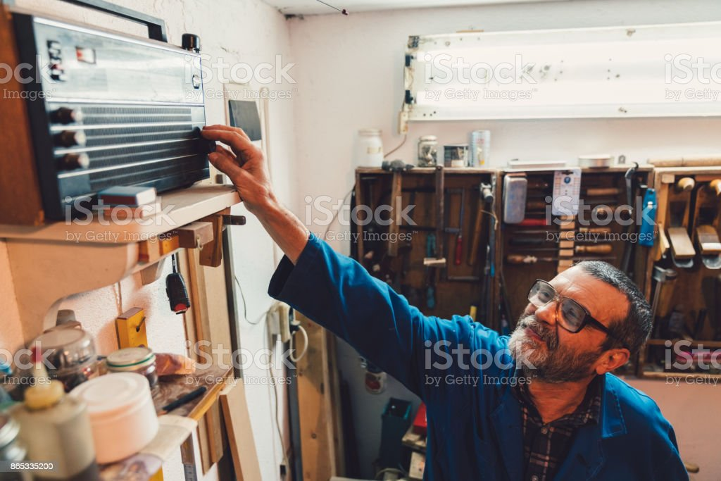 Workman turns on the radio stock photo