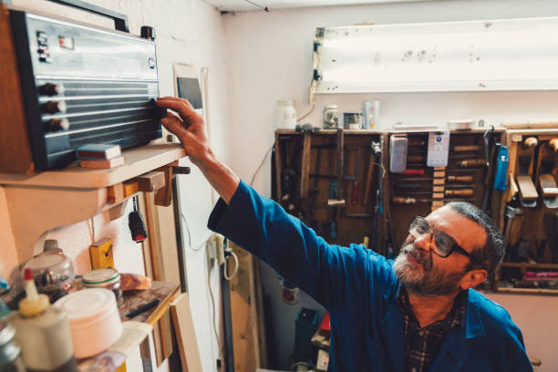 workman turns on the radio - radio station stock photos and pictures