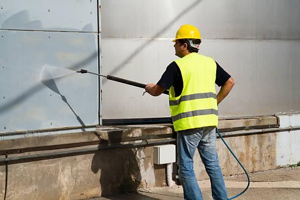 workman washing stock photo