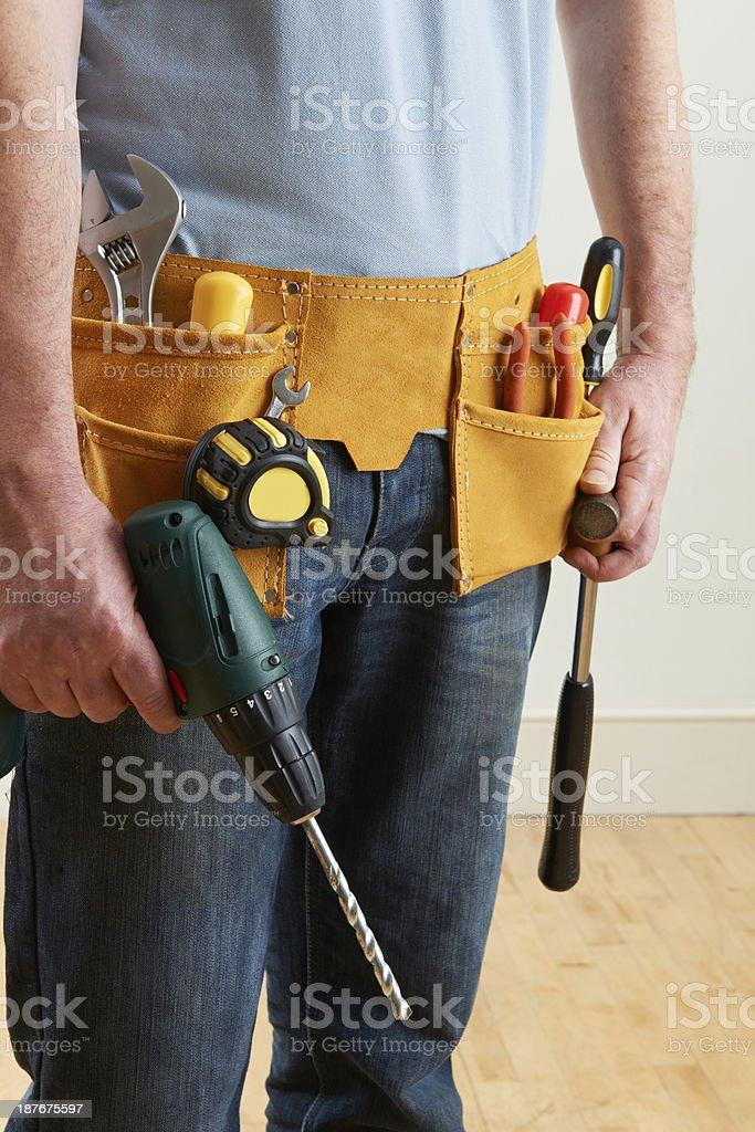 Workman Wearing Toolbelt royalty-free stock photo