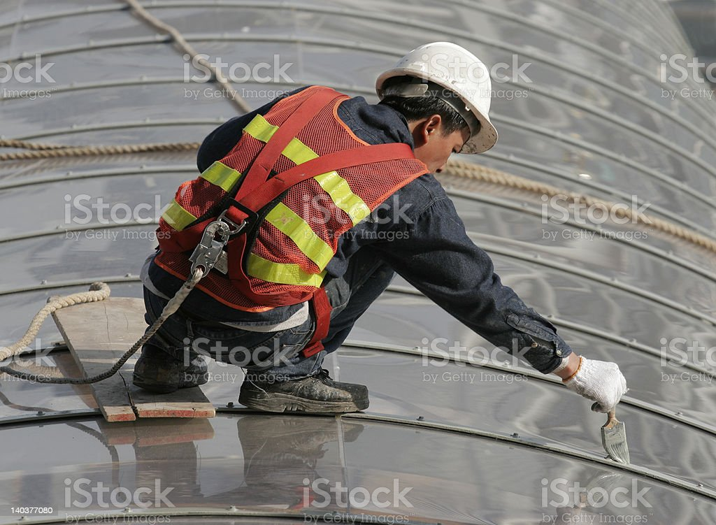 Workman with safety harness stock photo