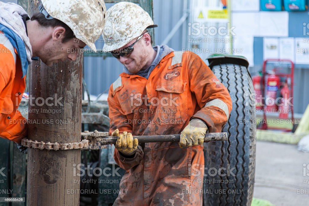 Workmen and a drilling a borehole stock photo