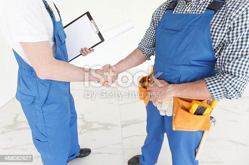 istock workmen handshake 488082622