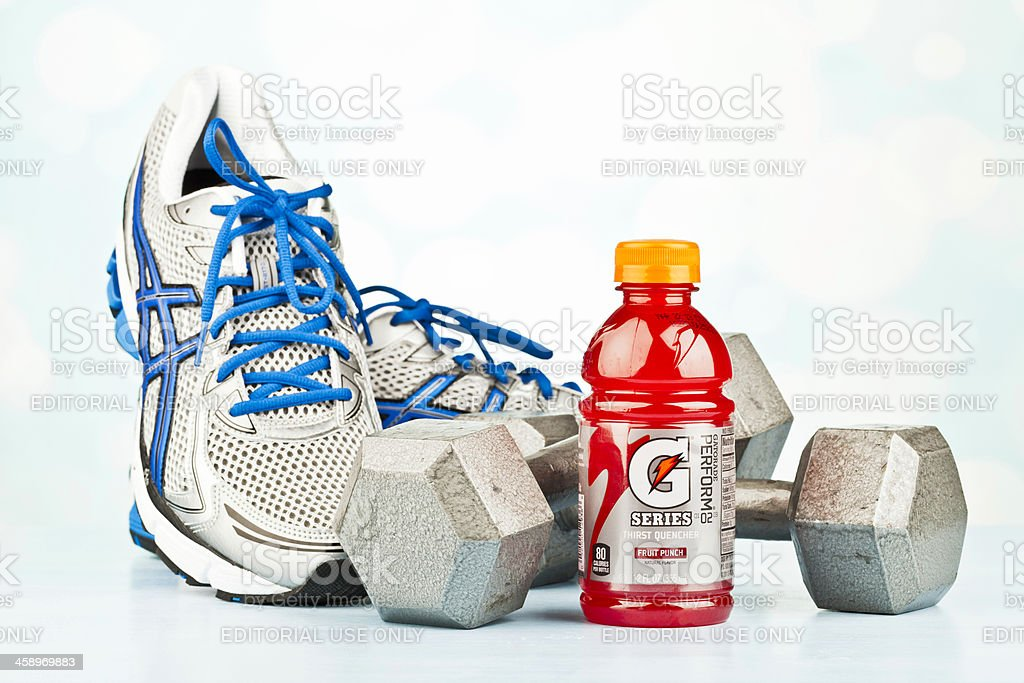Workout Essentials Sports Shoes Dumbbells And Gatorade Stock Photo