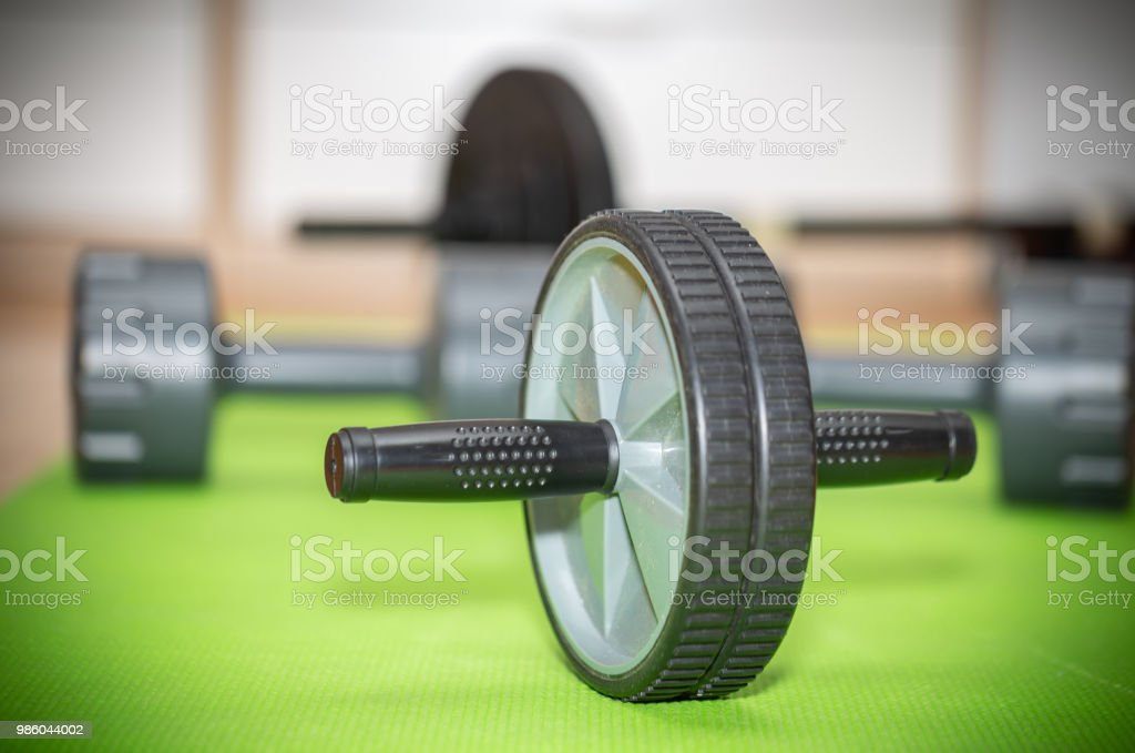Workout Fitness Exercise Roller. Black And Gray Color On The Green...