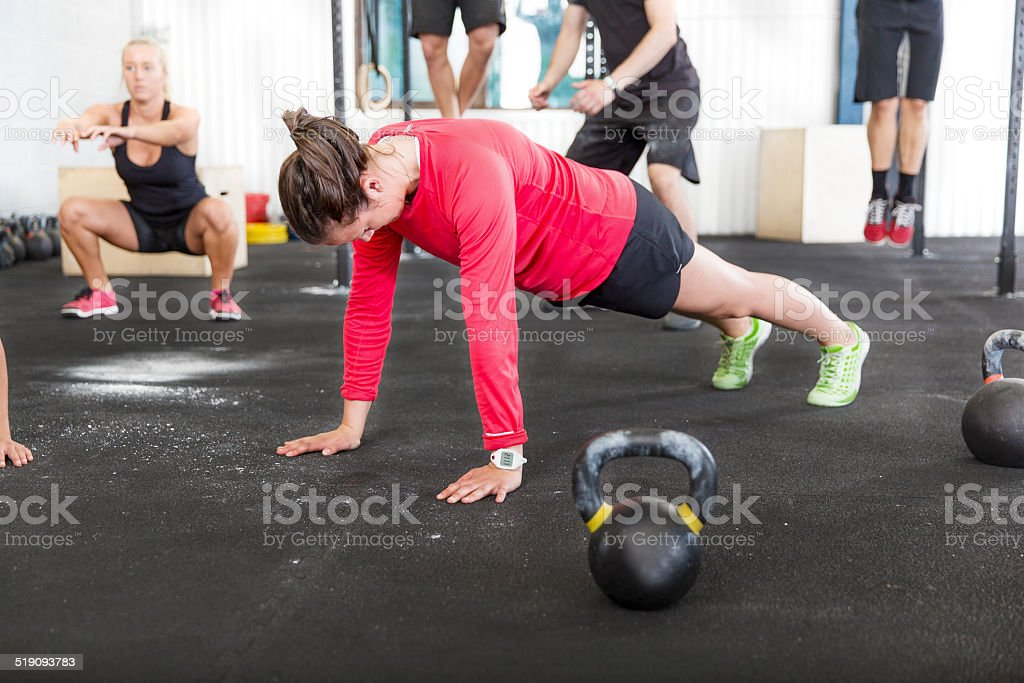 Workout group trains different exercises stock photo