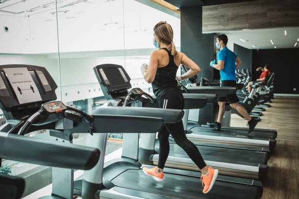 workout in gym after pandemic - social distancing stock pictures, royalty-free photos & images