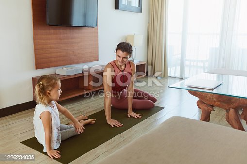 916126642 istock photo Workout. Mother And Kid Exercising At Home. Little Girl And Young Woman Practicing Together In Living Room. Sport Routine For Active Lifestyle. 1226234035