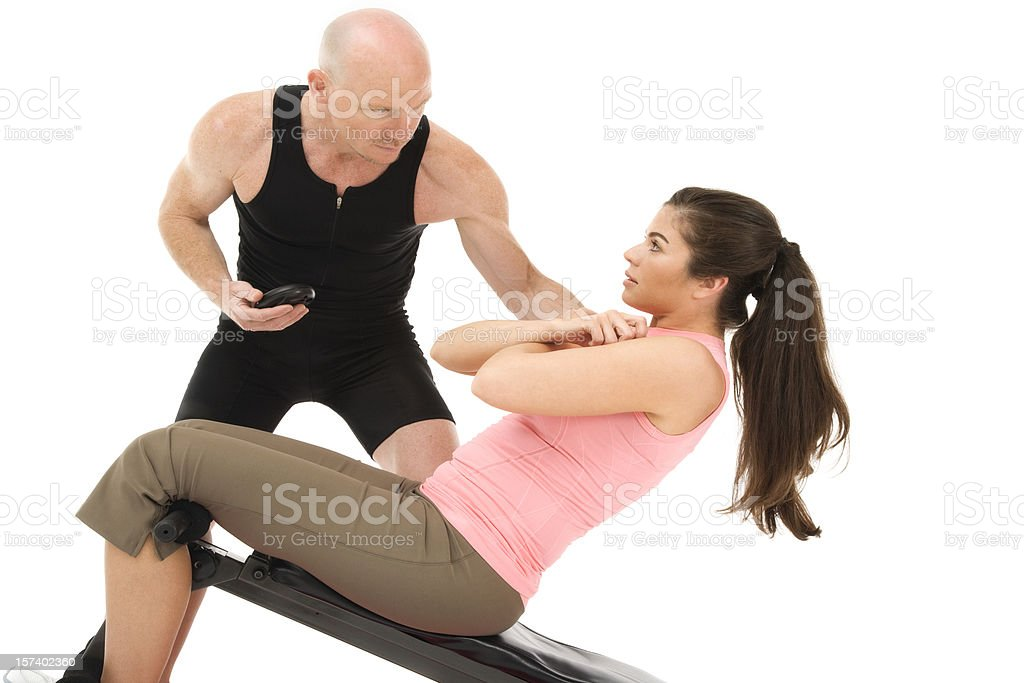 Workout partners training male female fitness coach healthy situps isolated royalty-free stock photo