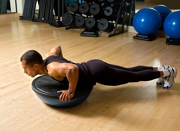 Workout with Bosu Ball Balance Trainer stock photo