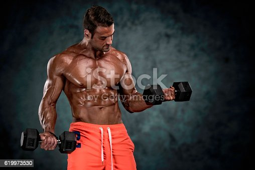 618209684istockphoto Workout with Weights 619973530