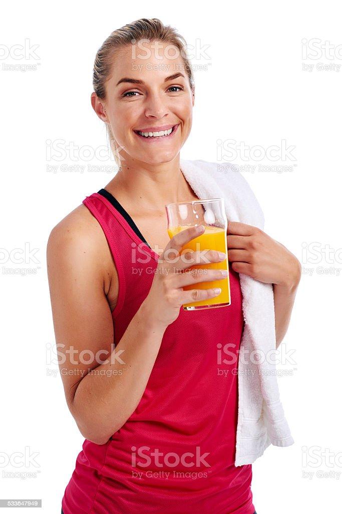 Workout woman drinking juice stock photo