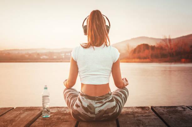 Workout yoga meditation outdoors stock photo