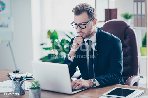 istock Workplace attorney success collar executive notary broker lawyer people corporate concept. Concentrated serious handsome pensive smart clever broker realtor recruiter using netbook at work 966258288