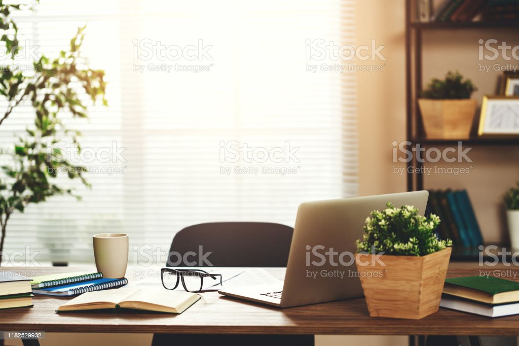 workplace   Desk with   computer at   window in   office at home in   apartment - Стоковые фото Без людей роялти-фри