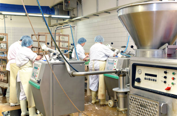 workplace food industry - factory butchery for the production of sausages stock photo