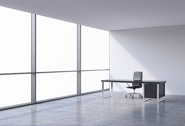 workplace in a modern corner panoramic office A workplace in a modern corner panoramic office, copy space on windows. A black leather chair and a black table. A concept of financial consulting services. 3D rendering. empty desk stock pictures, royalty-free photos & images