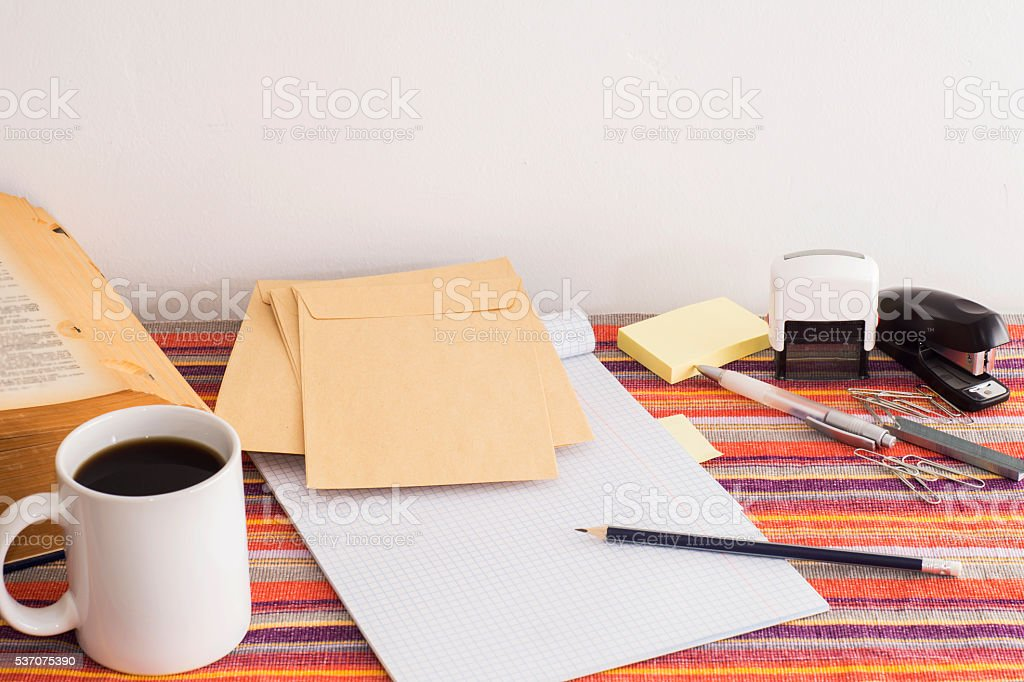 Workplace in vintage style: envelopes, notebook, book, stationer stock photo