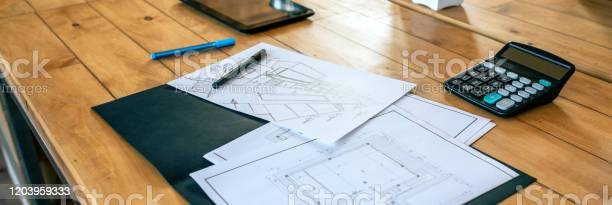 Workplace of an architect with blueprints and sketches picture id1203959333?b=1&k=6&m=1203959333&s=612x612&h=dy0jsy tyfnsuvpizfyn0dpoyjvfwyszri6epsizpzi=