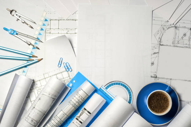 Workplace of architect - rolls and plans. Workplace of architect - Architect rolls and plans.architectural plan,technical project drawing. Engineering tools view from the top. Construction background. blotter stock pictures, royalty-free photos & images