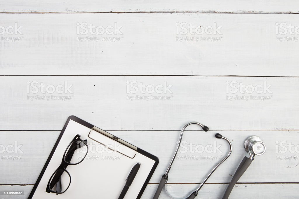 Workplace of doctor - stethoscope, medicine clipboard, glasses stock photo