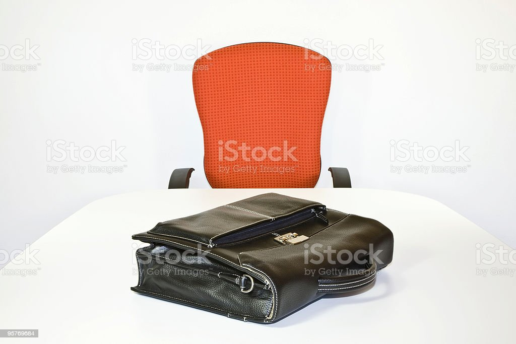 Workplace, Orange Office Chair and Briefcase on White Table royalty-free stock photo