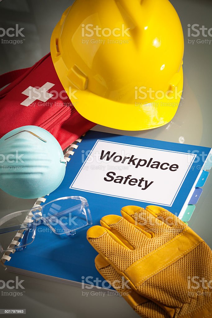Workplace Safety Handbook Manual and Equipment Vertical Close-up stock photo