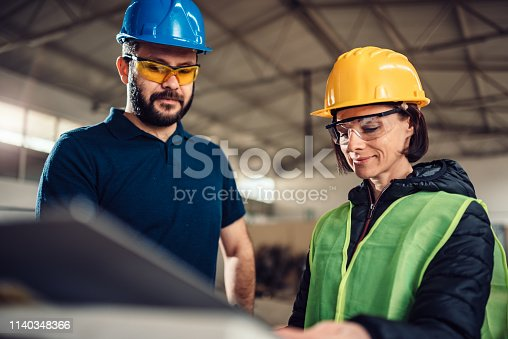 istock Workplace safety inspector at industrial factory 1140348366