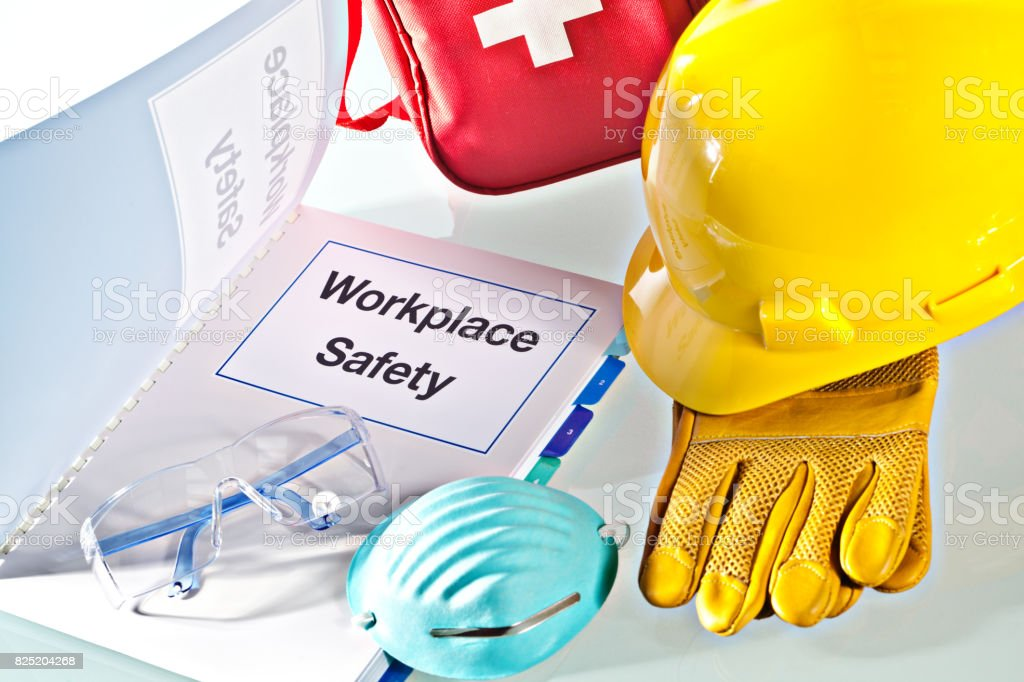 Workplace Safety Manual Document Book  with Safety Equipment Still Life stock photo