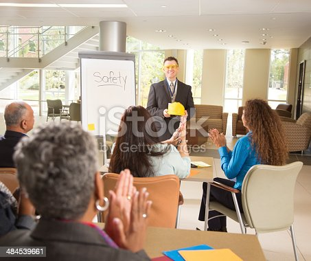 istock Workplace safety presentation with diverse workers 484539661