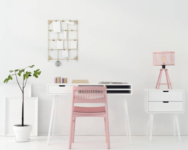 arbeitsplatz mit einem rosa stuhl - arbeitszimmer möbel stock-fotos und bilder