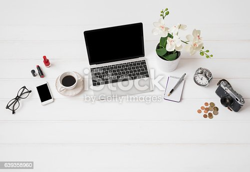 istock Workplace with laptop computer and different items 639358960