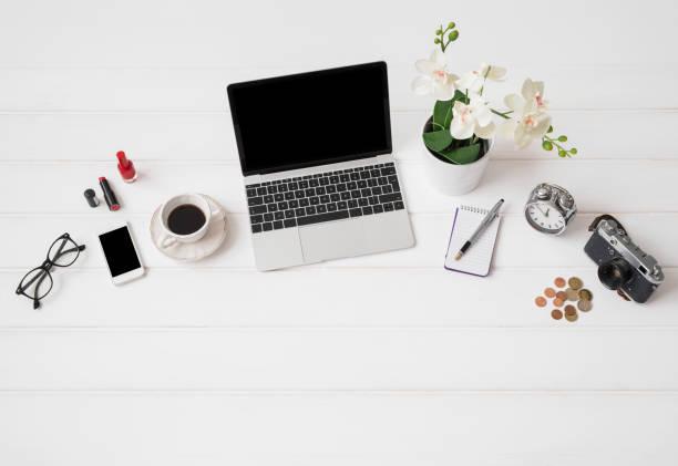 workplace with laptop computer and different items - tastatur bilder stock-fotos und bilder