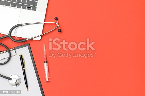 Medical healthcare background. Flat lay objects with copy space. Stethoscope, laptop computer on colored table. Medicine concept