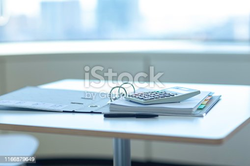 istock Workplace with notebook, pen and calculator on the desk. 1166879649