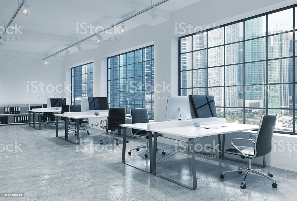 Workplaces in a bright modern loft open space office. Singapore