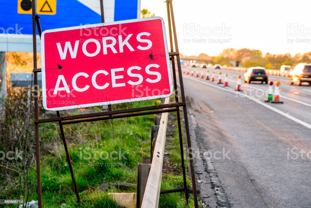 Works Access Only Sign on UK Motorway Evening royalty-free stock photo