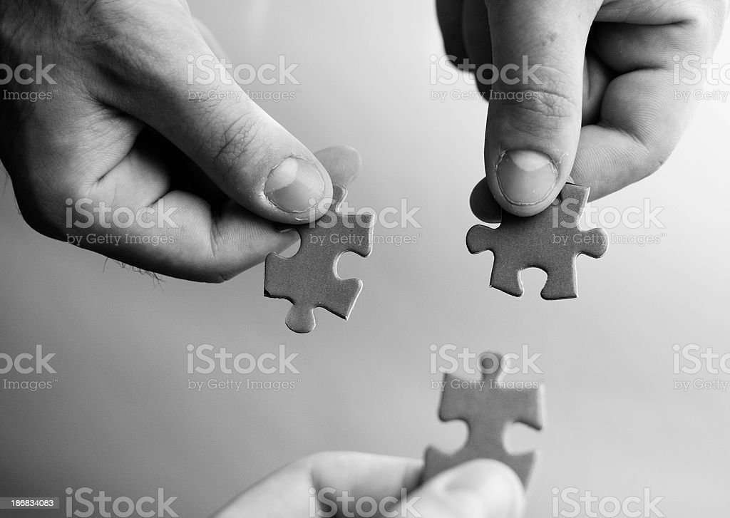 Works Connection : holding the puzzle royalty-free stock photo