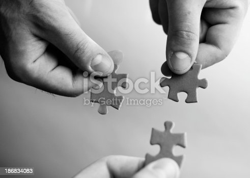 173706624istockphoto Works Connection : holding the puzzle 186834083