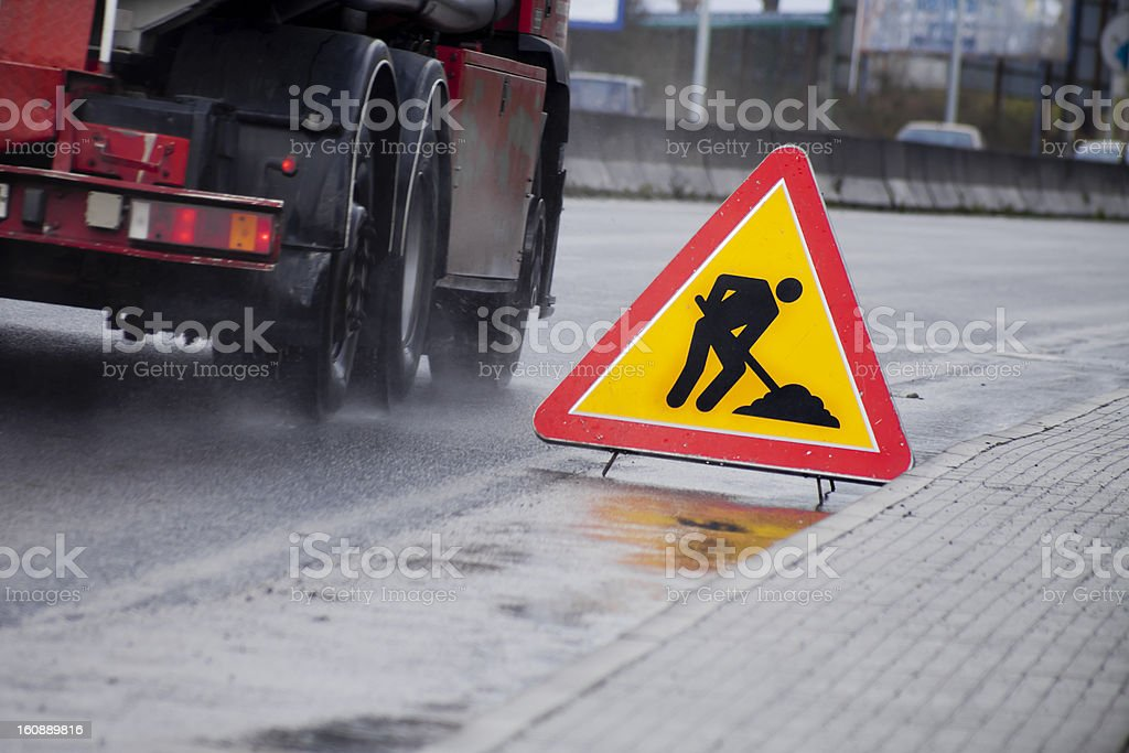 Works in progress road sign stock photo